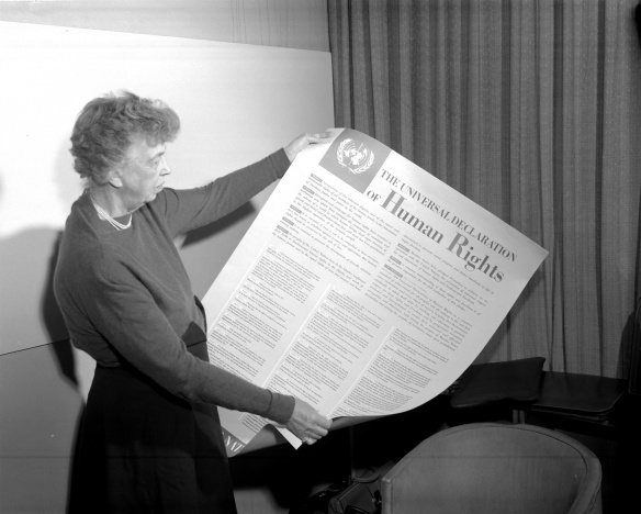 Mrs. Eleanor Roosevelt of the United States holding a Declaration of Human Rights poster in English. November 1949. Credit; UN Photo