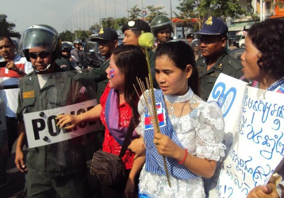 The women of Boeung Kak Lake protest the destruction of their homes in 2012 (pictured centre: famous land activist Tep Vanny)